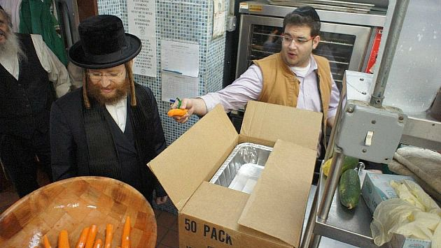 Helping Hand: Volunteers from Masbia Soup Kitchens/Met-Council and Chaverim prepare emergency food for seniors affected by Sandy at the Park Slope Armory in Brooklyn.