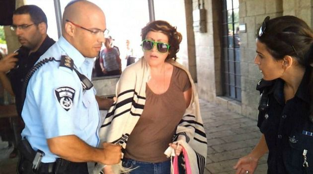 For All? Deb Houben of Boston is bundled away by police for wearing a prayer shawl ?incorrectly? at Western Wall last summer.