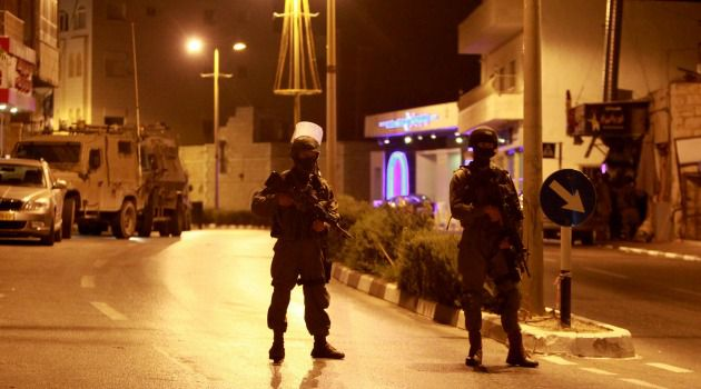 Crackdown: Israeli soldiers patrol in West Bank as part of crackdown following kidnapping of three Jewish teenagers.