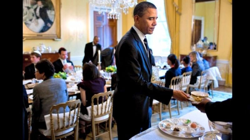 Former President Barack Obama is handed a bowl of matzo-ball soup.