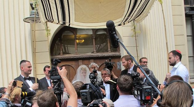Rebirth: Media crowd in in front of the chuppah at the wedding in Wroclaw, Poland, of Katka Reszke and Slawomir Grunberg outside the city's White Stork synagogue.