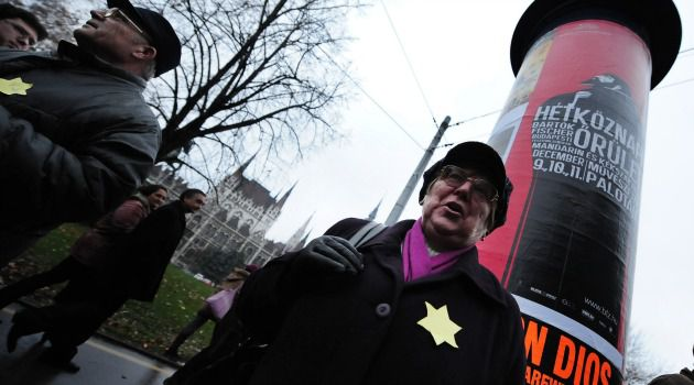 Complicit: Hungarians wear yellow stars to protest anti-Semitism. A project spotlights Hungary?s practice of keeping Jews in so-called Yellow Star Homes while awaiting deportation by Nazis.