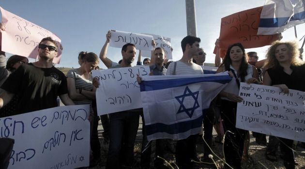 Israeli reservists protest violence by extremist Jewish settlers.