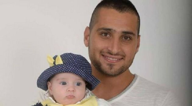 Zidan Saif in a family photo with his daughter.