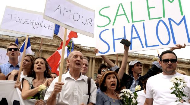 Jewish and Muslim demonstrators advocate peace at a rally in Paris.