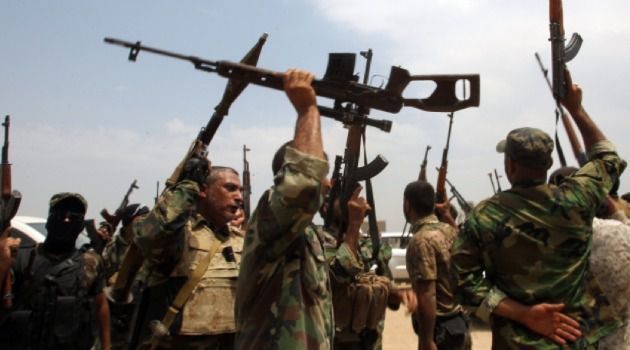 On the March: Anti-ISIS Shiite fighters in Iraq.