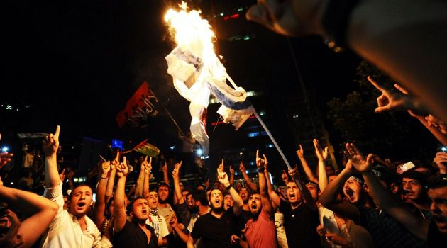 Rage on Streets: Angry Turkish demonstrators protest outside Israeli consulate in Ankara.