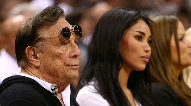 Digraced: Donald Sterling, owner of the Los Angeles Clippers, watches game with girlfriend.