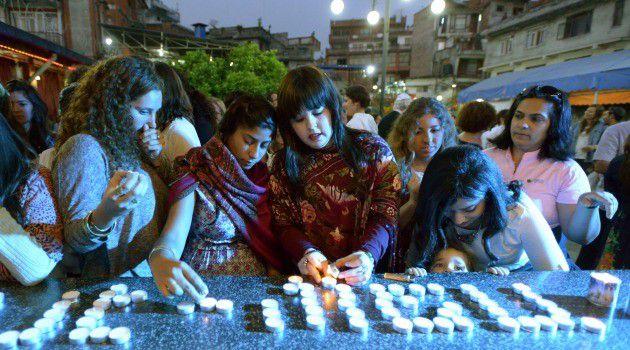 Annual Rite: Jewish women light candles at last year's Passover seder in Kathmandu, Nepal.