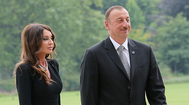 Caucasus Friend: Ilham Aliyev and his wife walk to a diplomatic function. The Azeri leader has forged stronger ties to Israel.