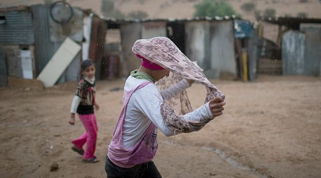 Ancient People: A Bedouin girl seeks shelter from rain. Israel?s efforts to force the nomadic Negev desert people into settlements have mostly ended in failure and confrontation.