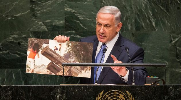 Dangerous Game: Benjamin Netanyahu shows photo of what he said was Palestinian children playing near a Hamas rocket launcher during his speech at the United Nations General Assembly.