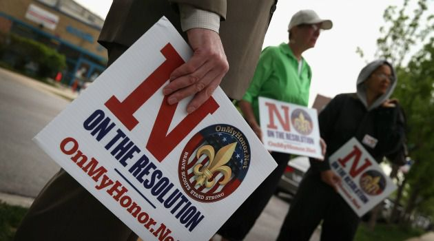 Not All Agree: Anti-gay demonstrators protest the Boy Scouts of America?s proposed lifting of a ban on gay scouts.