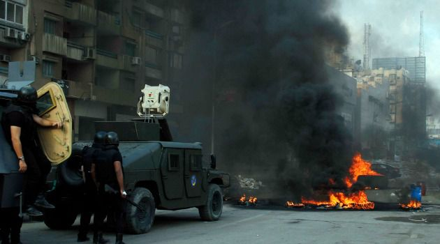 Bloody Crackdown: Egyptian troops move in to clear Islamist demonstrators from a camp in Cairo.