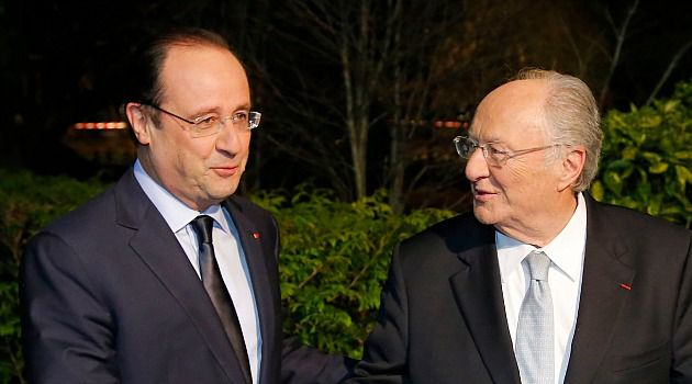 French Jewish leader Roger Cukierman greets French President Francois Hollande ahead of an annual community dinner.