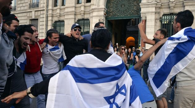 Banding Together: French Jews dance at a pro-Israel rally in front of a synagogue in Lyon.