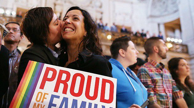 Historic Decision: Couple celebrates the Supreme Court's decision to strike down the Defense of Marriage Act. The court also blocked California's anti-gay marriage Proposition 8, although it stopped short of proclaiming a fundamental right to gay marriage.