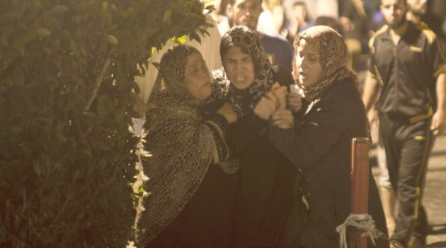 More Bloodshed: Anguished relatives mourn deaths of Hamas militants killed in Israeli air strike on Gaza.