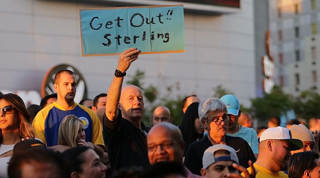 Sell Now: Los Angeles Clippers season ticket holder David Alt joins protest against owner Donald Sterling outside Staples Center.
