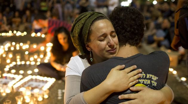 Unity Amid Divisions: Israelis comfort one another after the bodies of three kidnapped teenagers were found.