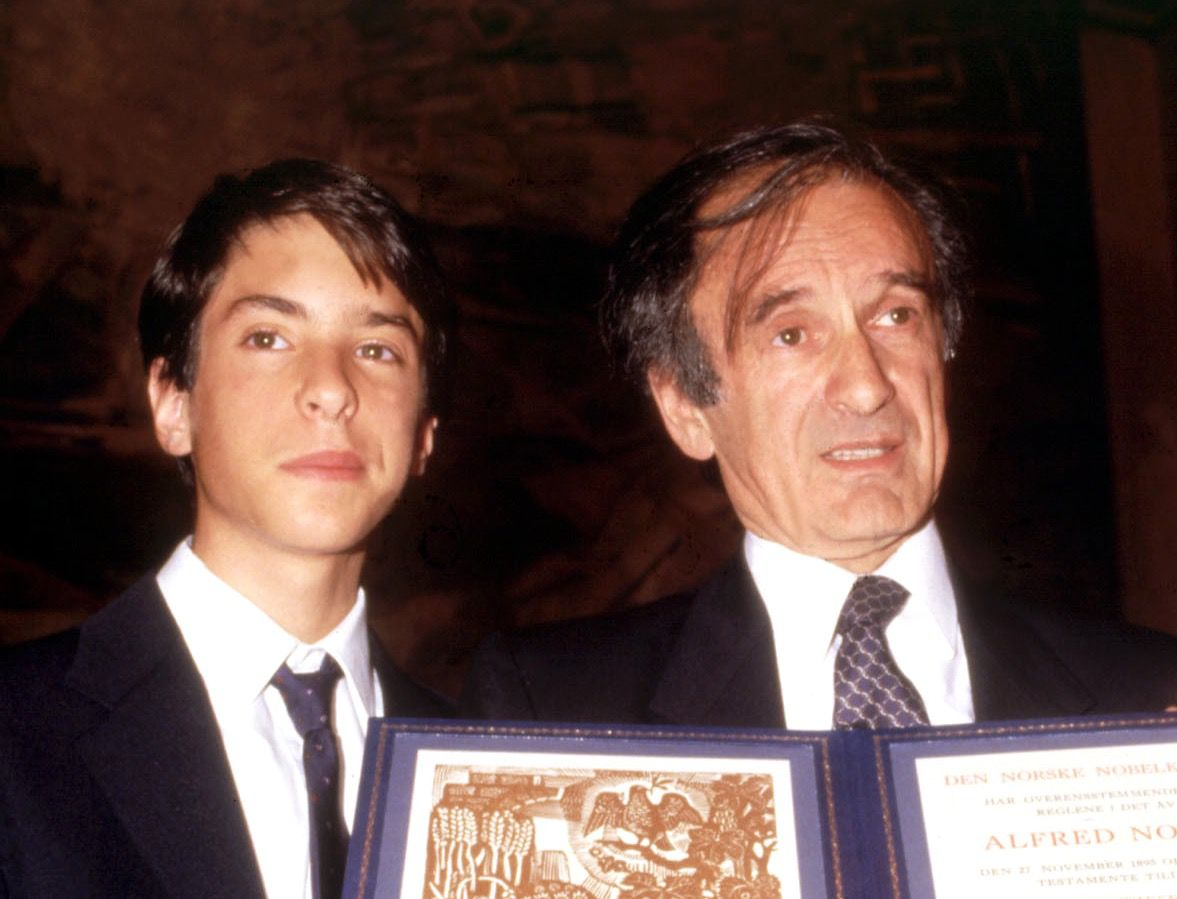 Elisha Wiesel (left) poses with his father at the Nobel Prize ceremony in 1986.