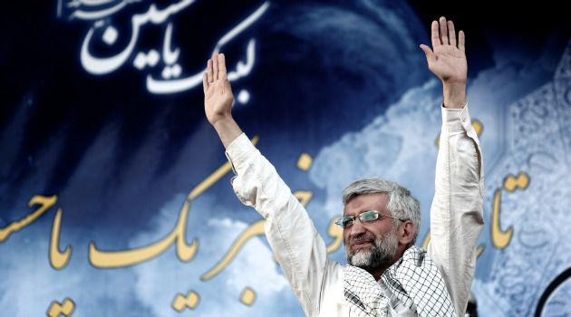 Sham Election? Saeed Jalili, Iran?s top nuclear negotiator and conservative presidential candidate, waves to supporters during campaign rally in Tehran.