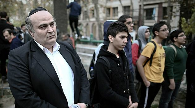 We Like Nukes: Iranian Jewish lawmaker Siamak Moreh Sedq and schoolboys read prayers during a demonstration in front of the United Nation?s building in Tehran.
