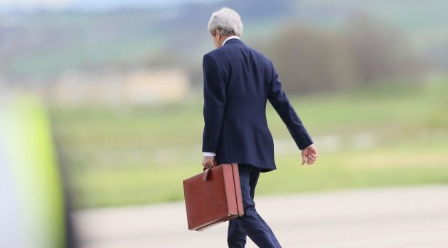 Lonely Path: John Kerry walks on an airport tarmac as he seeks to reach a deal to extend Mideast peace talks past an end of April deadline.
