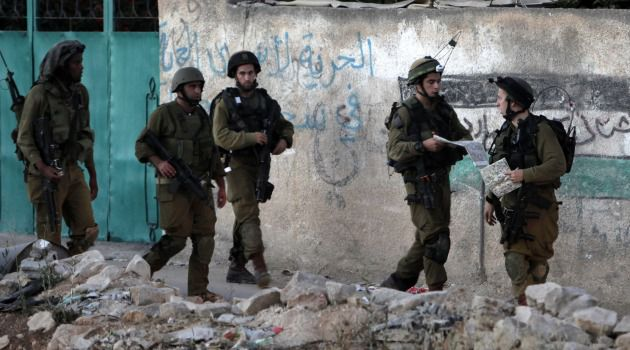 Sweep Continues: Israeli soldiers raid a Palestinian village as part of the crackdown stemming from the kidnapping of three Jewish teenagers.