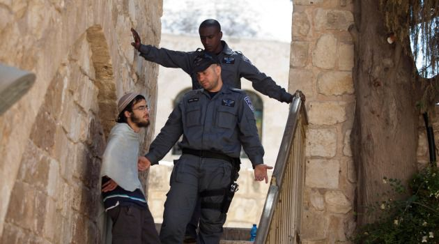 Francis Friction: Israeli police block a Jewish protester from entering holy site in Jerusalem.
