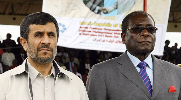 2 Peas in a Pod? Former Iranian President Mahmoud Ahmadinejad appears with Zimbabwe leader Robert Mugabe at a trade fair in the southern African nation.