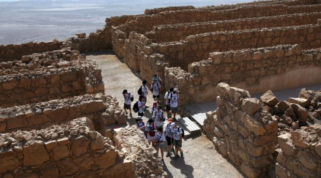 Tourists explore Masada, the popular site near the Dead Sea.
