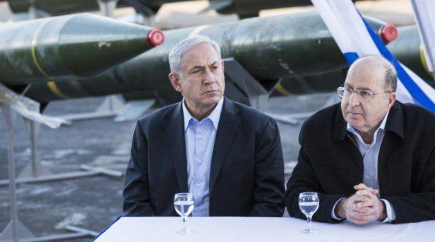 Hardline Defense Minister Moshe Yaalon sits next to Prime Minister Benjamin Netanyahu.