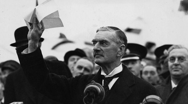 No Peace in Our Time: British Prime Minister Neville Chamberlain flashes the agreement with Adolf Hitler that he claimed ensured peace with the Nazi madman.