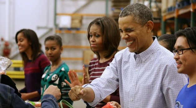 Dishing Out: President Obama and the First Family hand out meals for Thanksgiving.