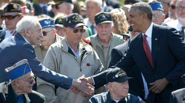 President Obama greets World War II veterans at the commemoration of the 70th anniversary of the D-Day landing on Normandy in France.