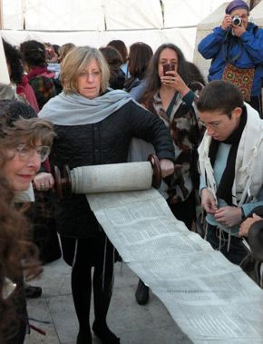 Illegal Prayer : Nofrat Frenkel (right), the author, reading from the Torah.