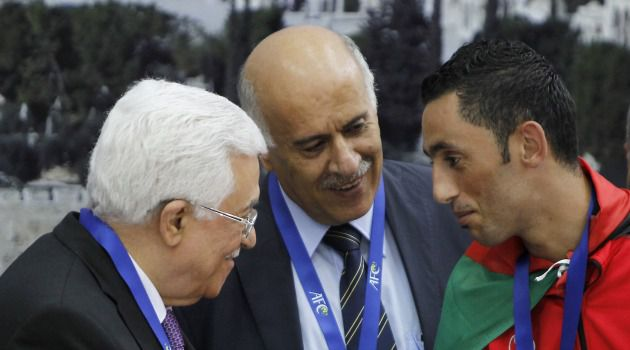 Post-Match Ashraf Nu'man (right) talks to Jibril Rajoub (center) and Mahmoud Abbas.