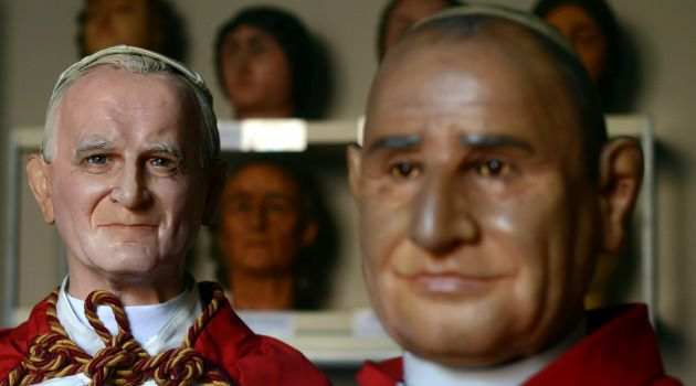 Jewish Heroes: Wax effigies of late popes John Paul II, left, and John XXIII are pictured at the Rome's wax museum.