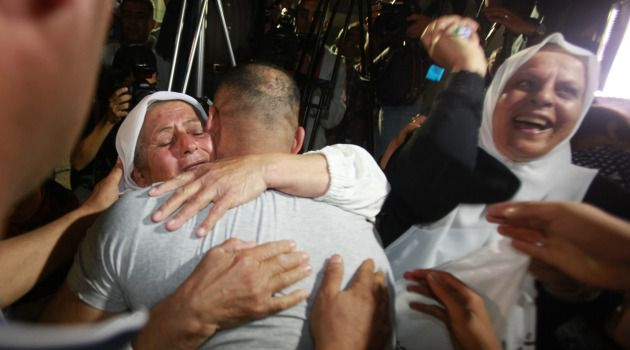 Free at Last: One of 26 Palestinian prisoners receives a welcome from relatives in Ramallah after being released by Israel on the eve of new peace talks.