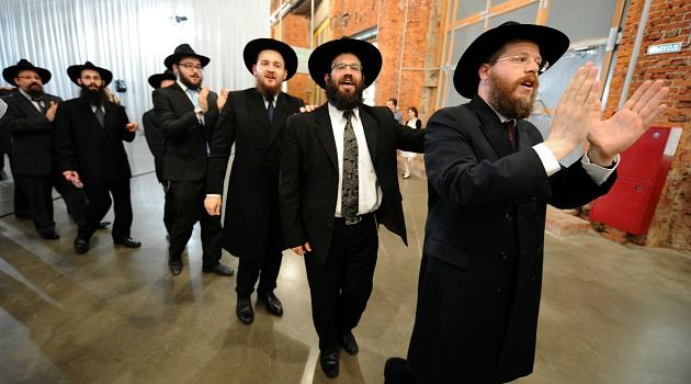 Russia Today: Jews celebrate at the opening of a new museum in Moscow. Russian Jews have long considered being Jewish to have little direct link with religious practice.
