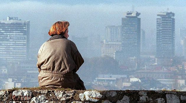 Bitter Days: Woman gazes over Sarajevo during brutal siege of the Bosnian city. In a sign of recovery, lions have been returned to the city?s zoo, where they once starved during the war.