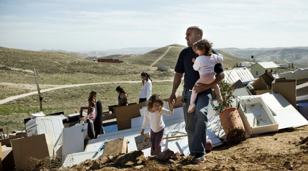 Forced Out: Jewish settlers in illegal outpost watch after home was destroyed by Israeli authorities.