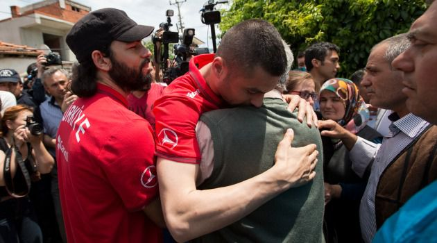 Shared Sorrow: Members of the Turkish national soccer team console relatives of the victims of a deadly mine collapse in the town of Soma.