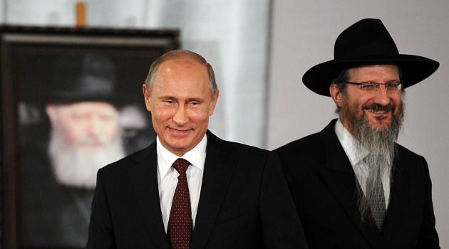 Nice Boy: Vladimir Putin shares a smile with Russian chief rabbi Berel Lazar.