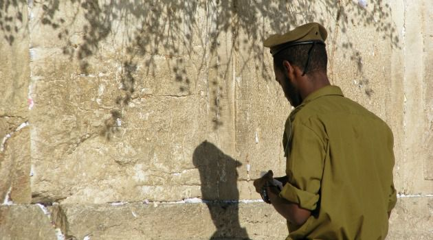 Fitting In: An Ethiopian-Israeli soldier prays at Western Wall in Jerusalem.