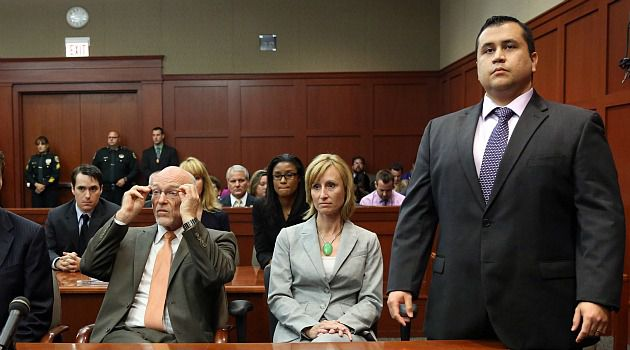 Free To Go: George Zimmerman stands as the judge prepares to announce his not guilty verdict in the killing of Florida teenager Trayvon Martin.