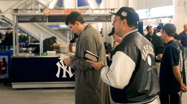 Time Out: A minyan formed at a kosher food stand in Yankee Stadium during the seventh-inning stretch.