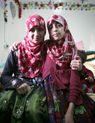 ?No Place Like Yemen?:  Shuma?a, right, eldest daughter of Rabbi Yahya Yousuf al-Marhabi, poses with an unnamed cousin.