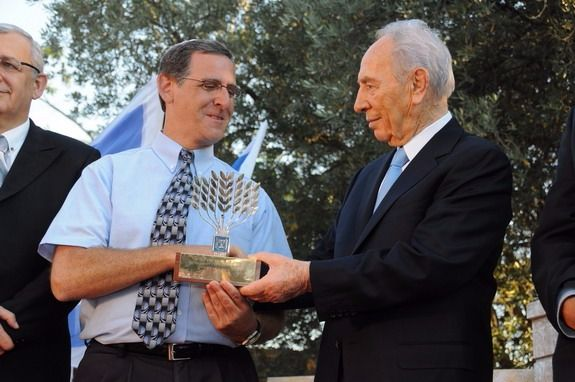 Dr. Yitz Glick was awarded the Presidential Award for Volunteerism by Shimon Peres in 2009 for his work.